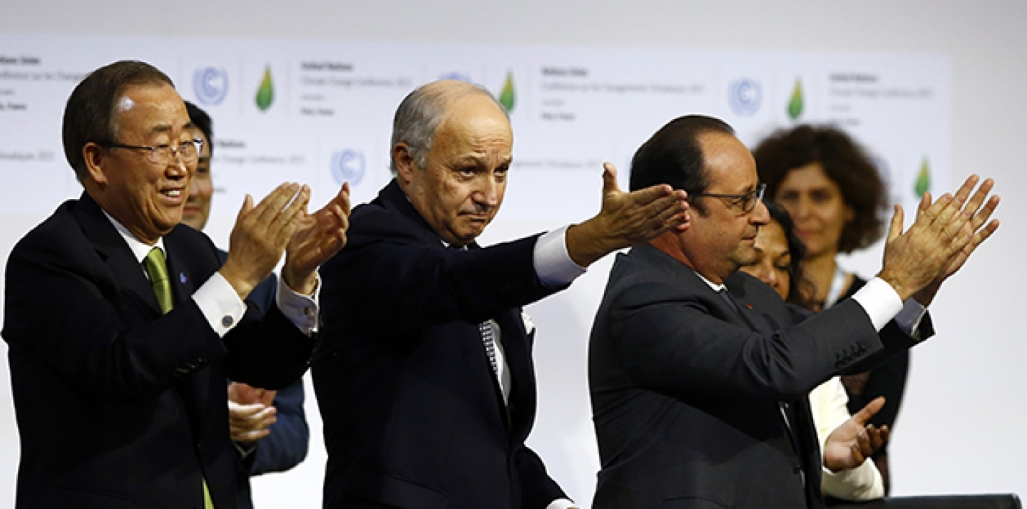 French President Francois Hollande, right, French Foreign Minister and President of the COP21 Laurent Fabius, center, and UN Secretary General Ban ki-Moon applaud after the final conference at the COP21, on Saturday, Dececmeber 12, 2015. (AP Photo/Francois Mori)