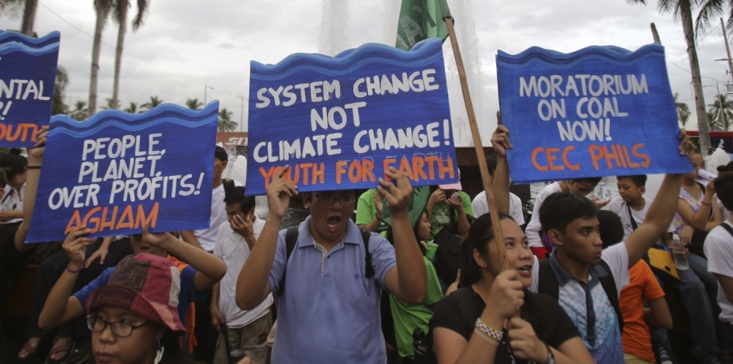 Filipino activists shout slogans during a play depicting the effects of climate change as they join the Climate Solidarity Prayer March in Manila back in November 2015. (AP Photo/Aaron Favila)