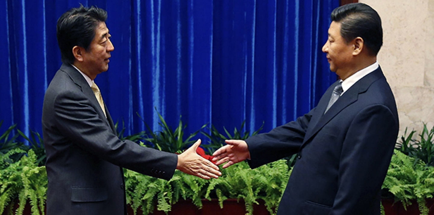 China's President Xi Jinping, right, shakes hands with Japan's Prime Minister Shinzo Abe, during their meeting at the Great Hall of the People, on the sidelines of the Asia-Pacific Economic Cooperation (APEC) summit. (AP Photo/Kim Kyung-Hoon, Pool)