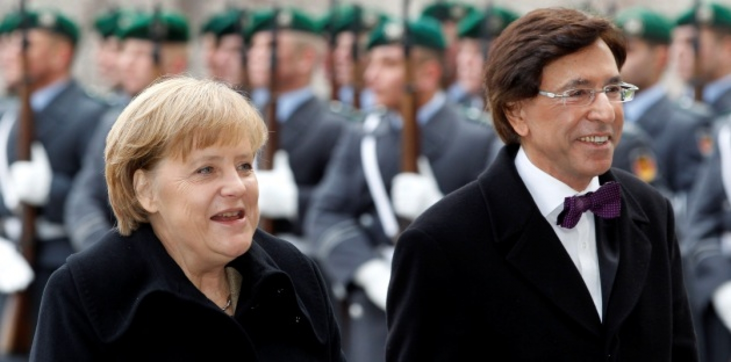 German Chancellor Angela Merkel, left, welcomes the Prime Minister of Belgium, Elio Di Rupo, right, with military honors at the chancellery in Berlin (AP Photo/Michael Sohn).