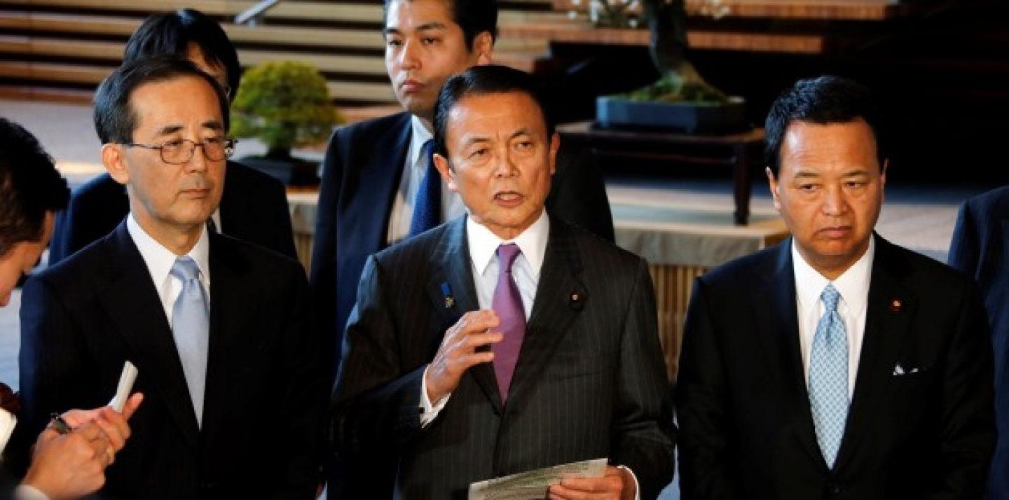 "Japan's Finance Minister Taro Aso, center, along with Economics Minister Akira Amari, right, and Bank of Japan Gov. Masaaki Shirakawa, left, speaks to reporters after meeting with Japan's Prime Minister Abe who declared a ""monetary regime change"" in January. (AP Photo/Koji Sasahara)"