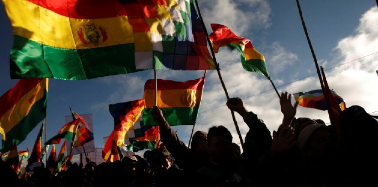 Supporters of Bolivia's President Evo Morales, holding up Bolivian flags. (AP Photo/Dado Galdieri)