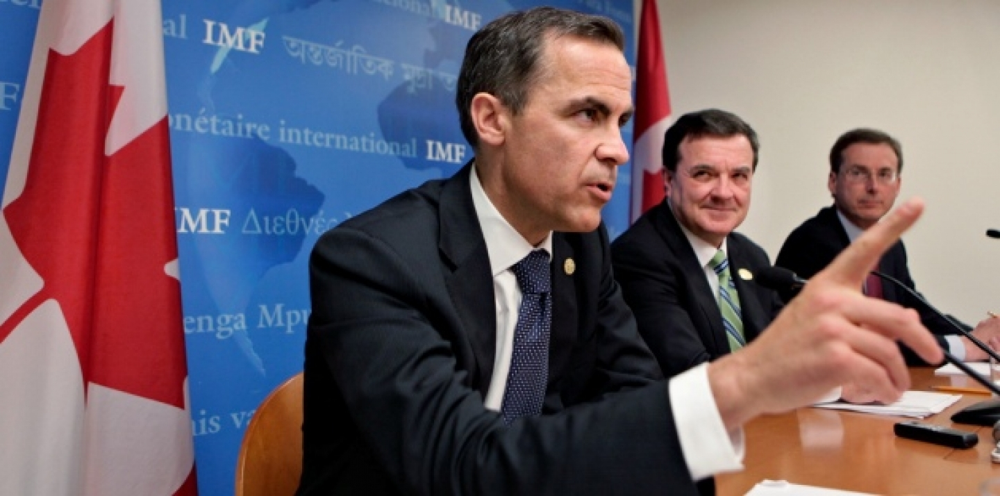 Bank of Canada Governor Mark Carney, left, and Canada's Finance Minister Jim Flaherty at the International Monetary Fund headquarters, 2009 (AP Photo/J. Scott Applewhite).