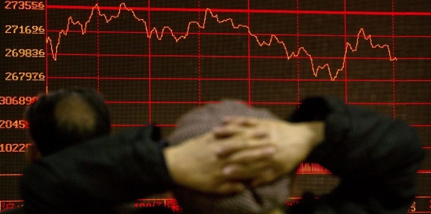 A Chinese investor monitors stock prices on an electronic display in a brokerage house in Beijing, Thursday, Jan. 28, 2016. Asian stock markets wavered Thursday after the Federal Reserve sounded a note of caution on the world economy and its effect on U.S. growth but left the door open for rate hikes. (AP Photo/Mark Schiefelbein)