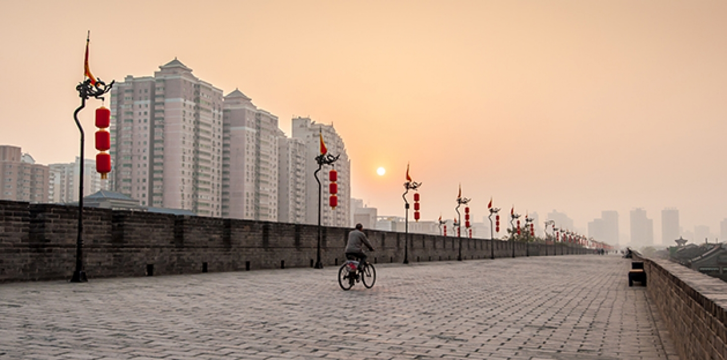 A bicycle rides at sunset in Xian, China. (Shutterstock)