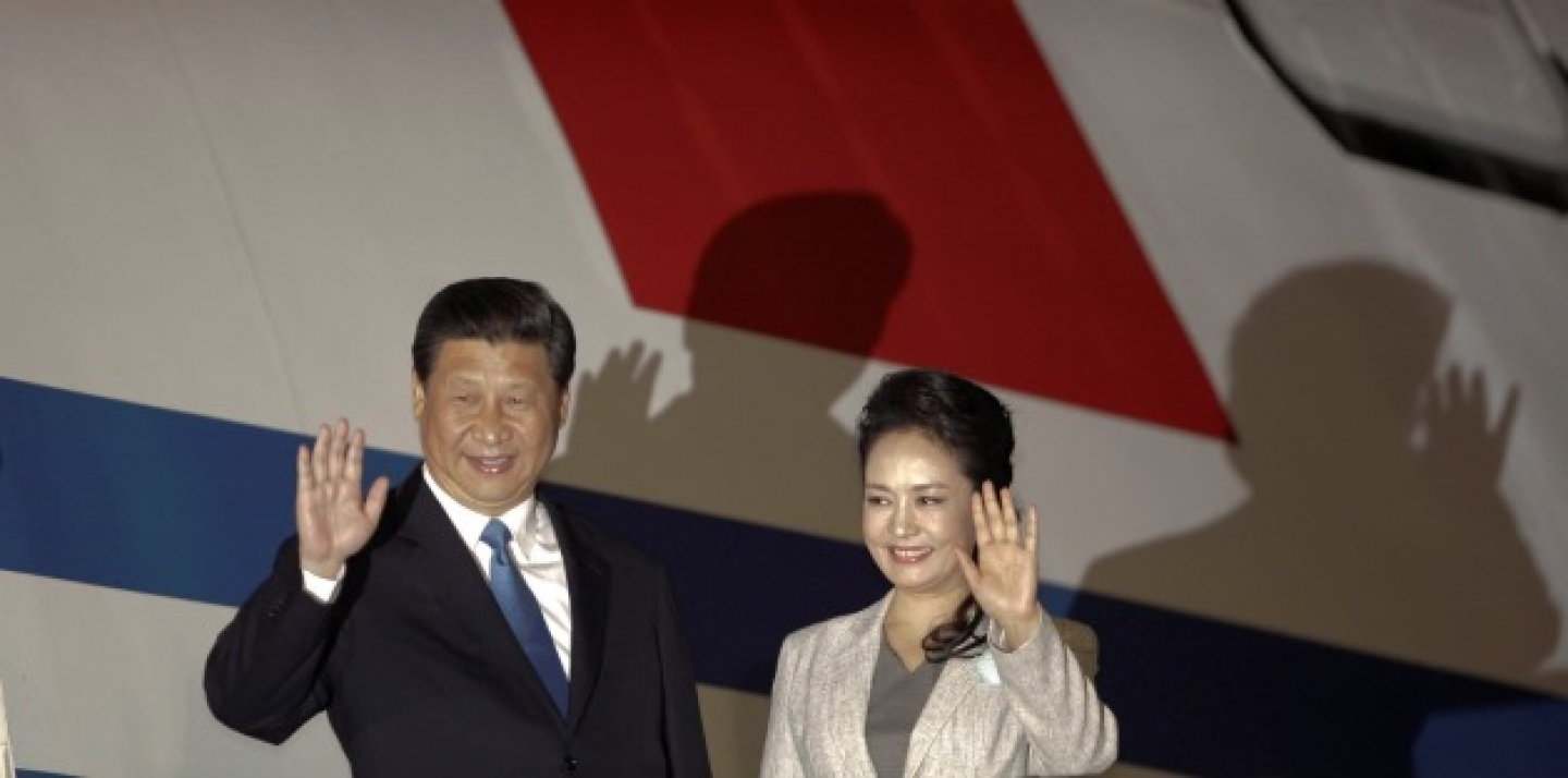 Chinese President Xi Jinping, left, and his wife Peng Liyuan wave to reporters upon their arrival to San Jose, Costa Rica. (AP Photo/Arnulfo Franco, File)