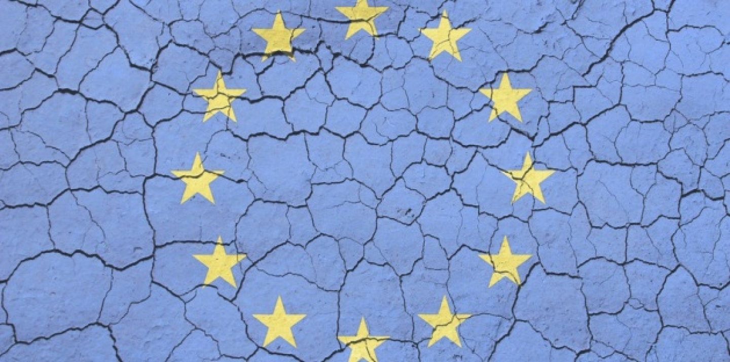 EU flag imposed on an image of cracking soil (AP Microstock).