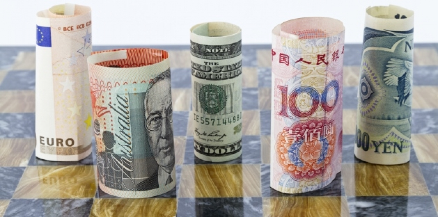Five currencies that influence global financial investments staged on a chess board. (Shutterstock)