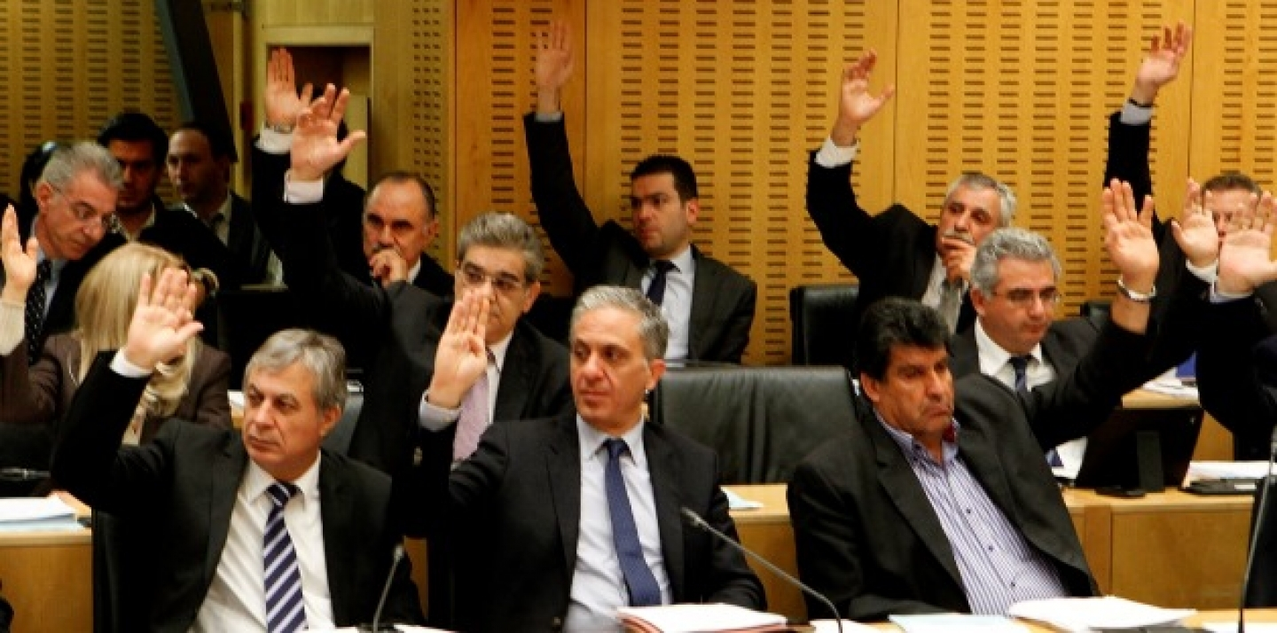 Cyprus lawmakers vote on key bills aimed at securing a broader bailout package from international creditors in parliament in capital Nicosia, Cyprus, late Friday, March 22, 2013. (AP Photo/Petros Karadjias)