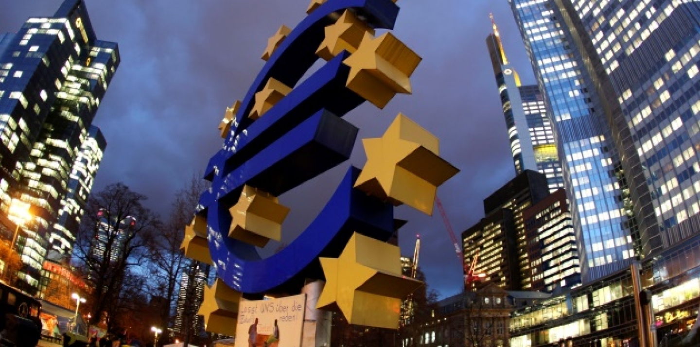 The Euro sculpture stands in front of the European Central Bank, right, in Frankfurt, Germany. (AP Photo/Michael Probst)