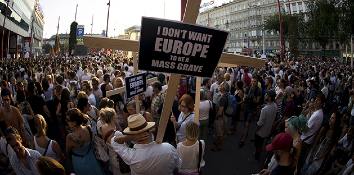 People demonstrate for a change in the European refugee policy in the Austrian capital Vienna Monday, Aug. 31, 2015. (AP Photo/Christian Bruna)