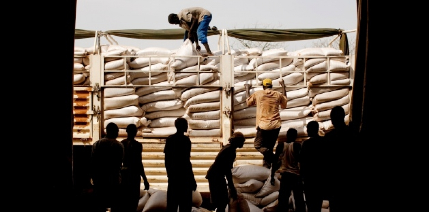 Workers unload food for distribution at the Yida refugee camp in South Sudan, May 2012 (AP Photo/Pete Muller).