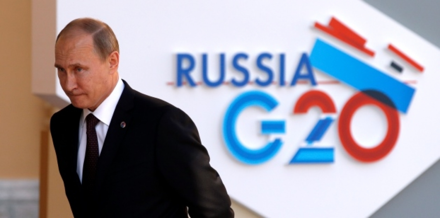 Russia's President Vladimir Putin waits for the arrival of G-20 leaders at the Konstantin Palace in St. Petersburg, Russia on Thursday, Sept. 5, 2013. (AP Photo/Alexander Zemlianichenko)
