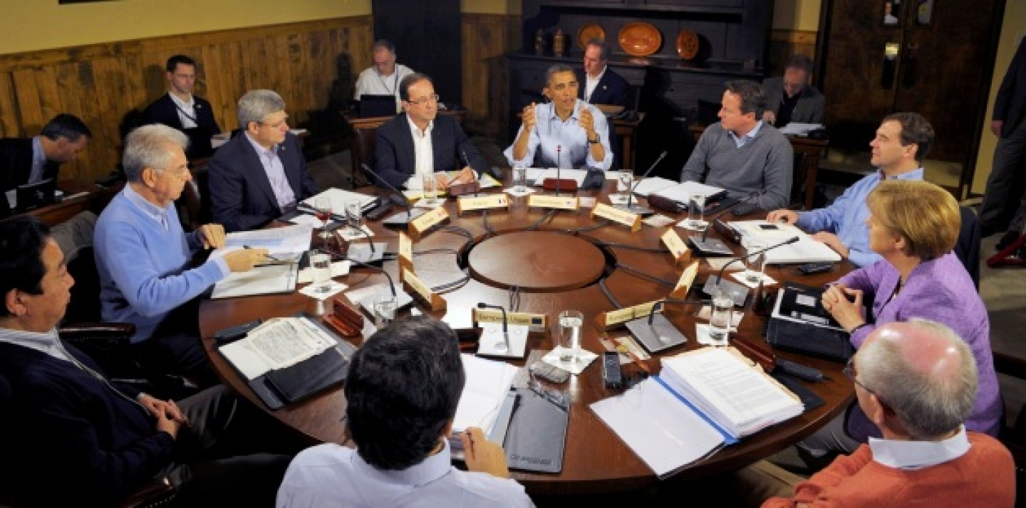 U.S. President Barack Obama, center, speaks at the start of the first working session of the G8 Summit at Camp David (AP Photo/Philippe Wojazer, Pool)