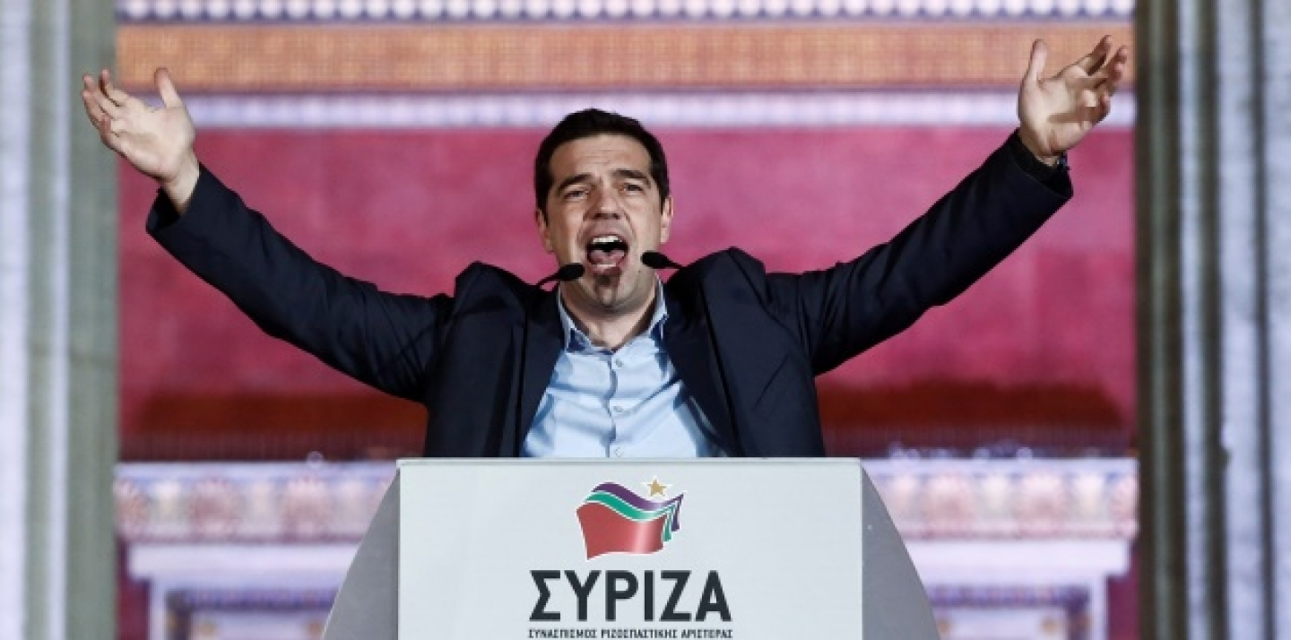 Leader of Syriza left-wing party Alexis Tsipras speaks to his supporters outside Athens University Headquarters, Sunday, Jan. 25, 2015. (AP Photo/Petros Giannakouris)