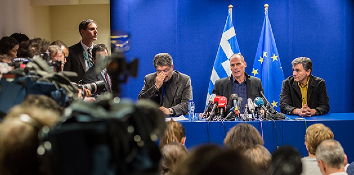 Greece's Finance Minister Yanis Varoufakis, second from right, addresses the media after a meeting of Eurogroup finance ministers at the EU Council building in Brussels on Monday, Feb. 16, 2015. (AP Photo/Geert Vanden Wijngaert)
