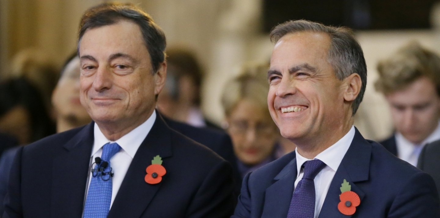 Mark Carney, Governor of The Bank of England, right, sits with Mario Draghi President of the European Bank, during The Bank of England's Open Forum Conference in London, Wednesday, Nov. 11, 2015.  (AP Photo/Kirsty Wigglesworth)