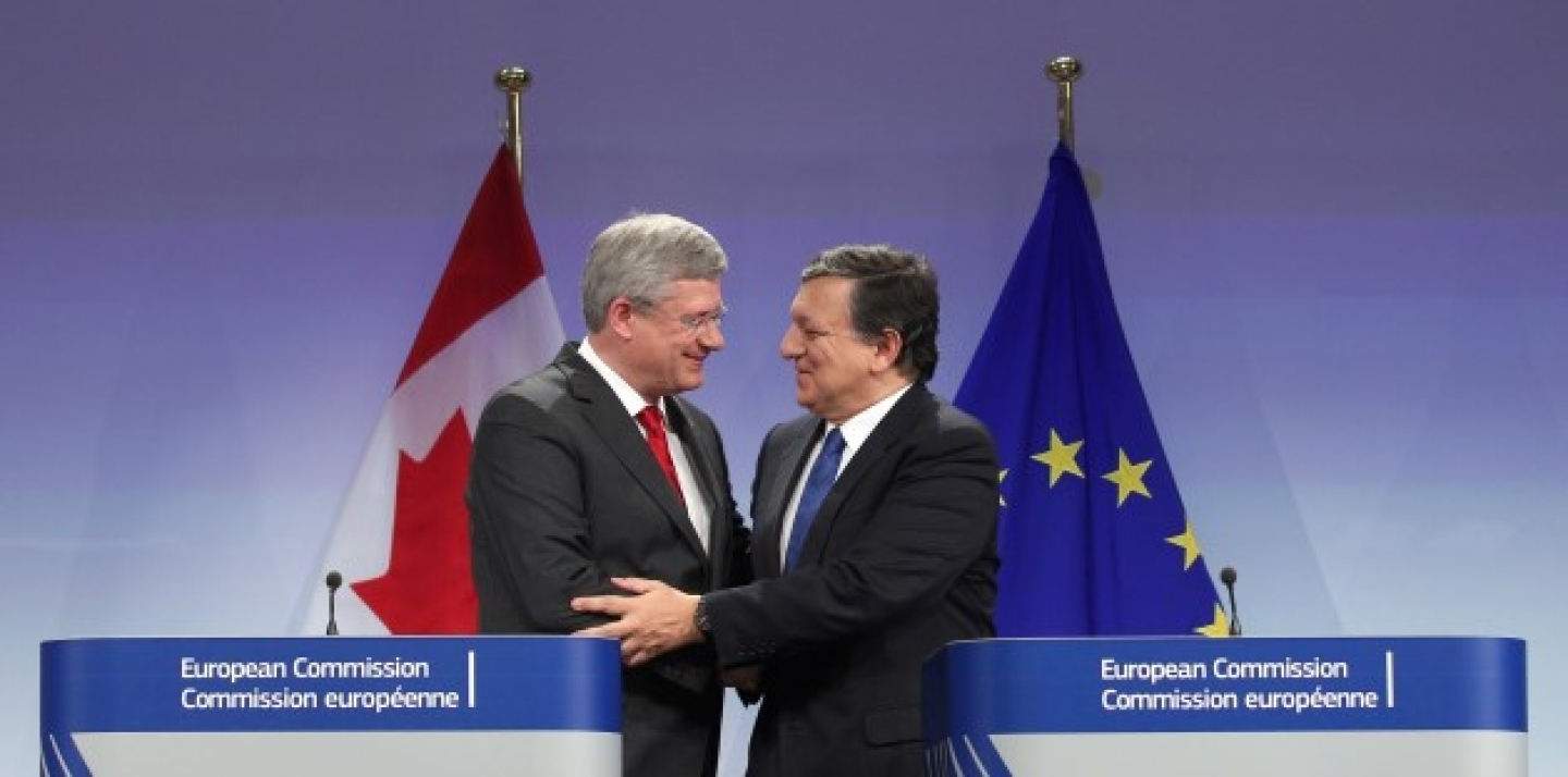 European Commission President Jose Manuel Barroso, right, shakes hands with Canada's Prime Minister Stephen Harper during a media conference at the European Commission headquarters in Brussels, Friday, Oct. 18, 2013. (AP Photo/Yves Logghe)