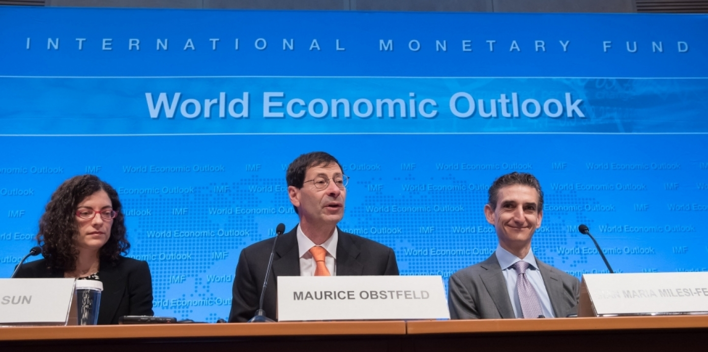 Maurice Obstfeld (center), IMF Economic Counsellor and Director of the Research Department, along with Oya Celasun (left) and Gian Maria Milesi-Ferretti, give remarks to the media during the World Economic Outlook press conference during the 2016 IMF Spring Meetings on Tuesday, April 12 in Washington, D.C. (Ryan Rayburn/IMF Photo)