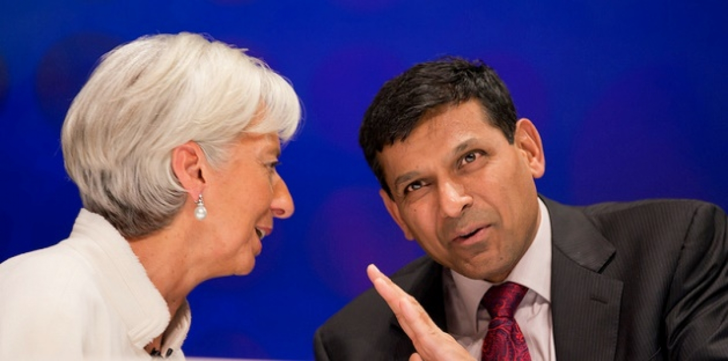 Christine Lagarde and Raghuram Rajan talk to each other after the 2012 BBC World Debate in Toyko, Japan. (IMF Staff Photograph/Stephen Jaffe)