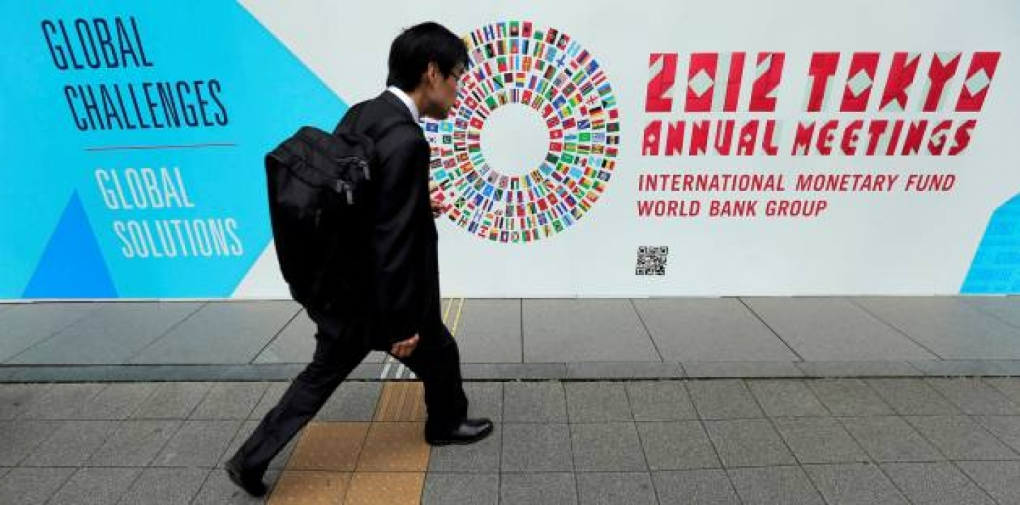 A man walks in front of the venue of the International Monetary Fund and World Bank meeting (AP Photo/Itsuo Inouye).