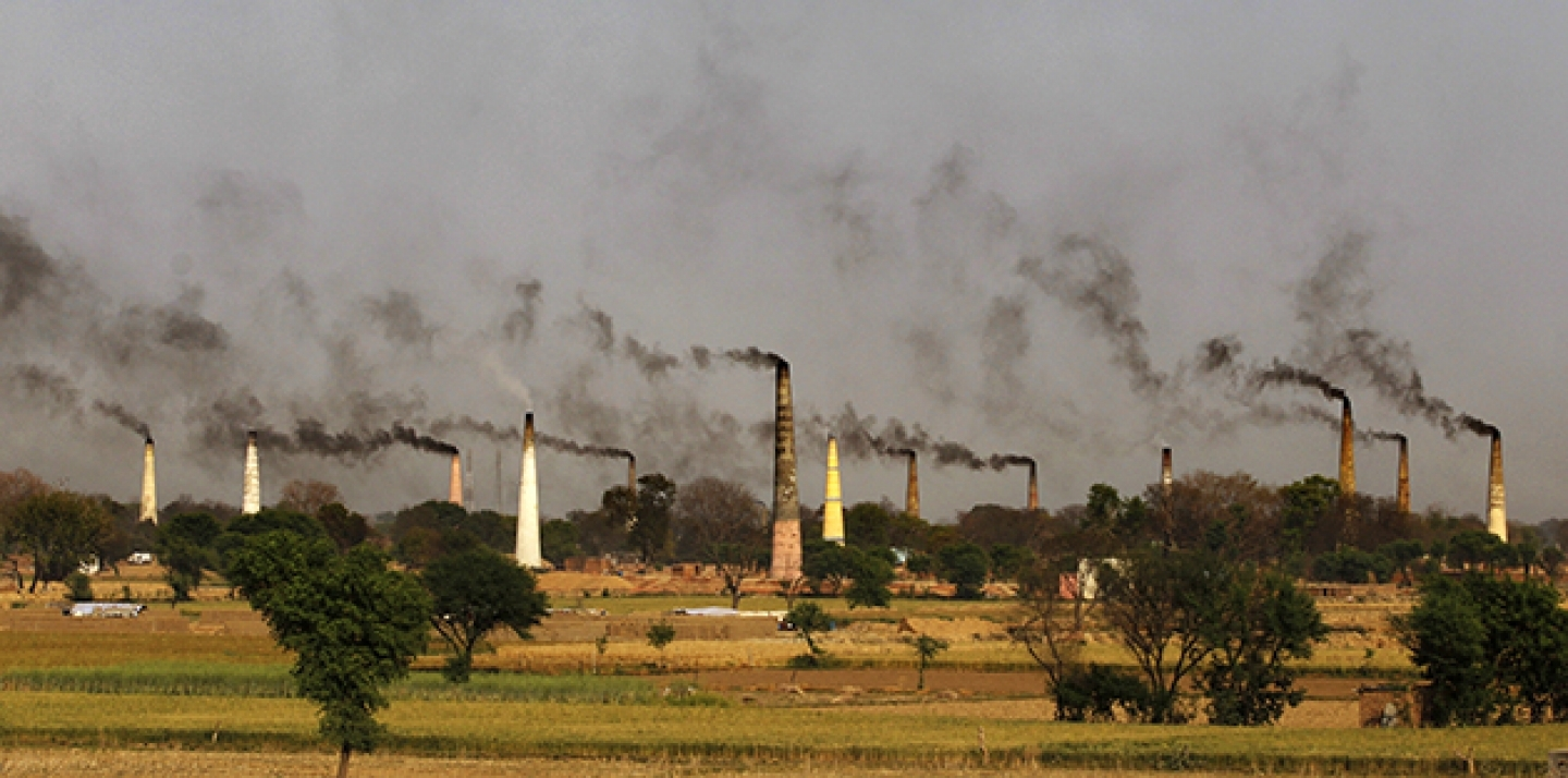 Smoke emits from the chimneys of numerous brick kilns on the outskirts of New Delhi, India. (AP Photo/Altaf Qadri)
