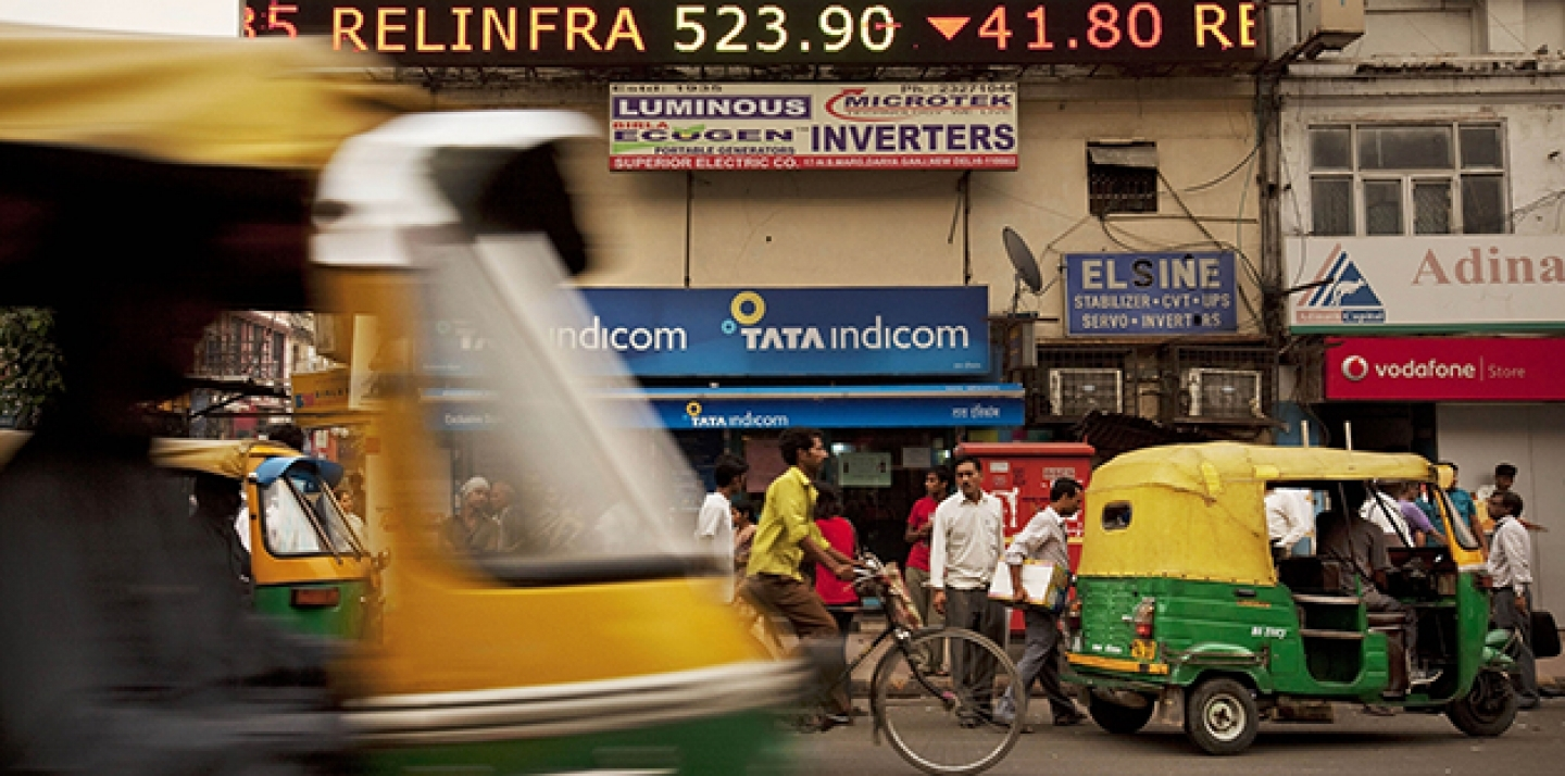 A stock ticker shows closing figures on the Bombay Stock Exchange (BSE) on a street in New Delhi, India. (AP Photo/Kevin Frayer)
