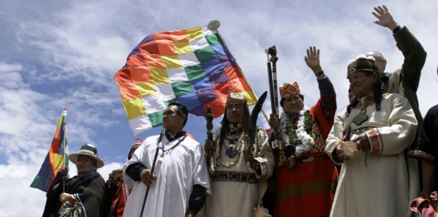 Holding the symbols of indigenous power, Bolivian President-elect Evo Morales, 2nd right, waves to supporters. (AP Photo/Dado Galdieri)