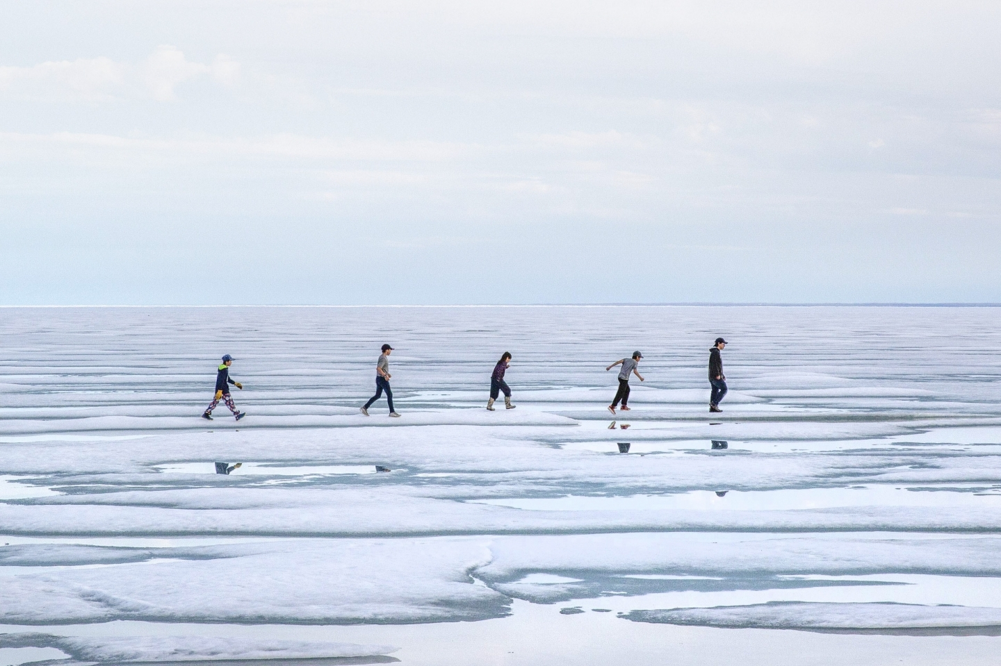 Children walk across summer sea ice just outside of Cambridge Bay, Nunavut. (Zachary Prong/Arctic Research Foundation)