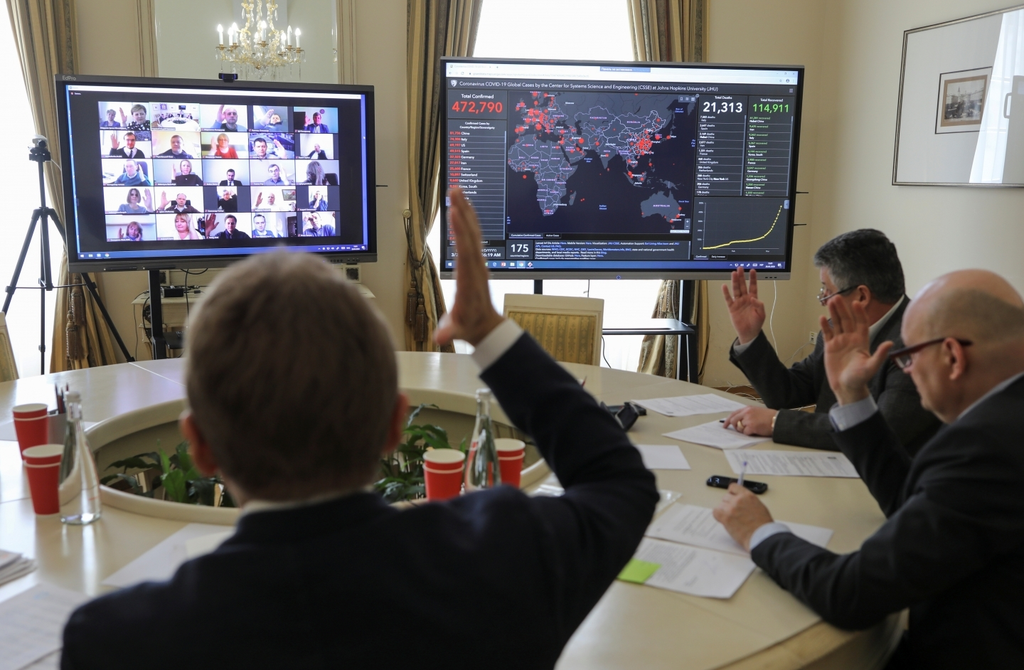 Members of the city commission to prevent the spread of coronavirus disease (COVID-19) vote during a meeting via Zoom video link in Lviv, Ukraine March 26, 2020. (REUTERS/Roman Baluk)