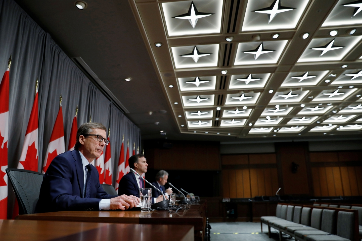 Bank of Canada governor designate Tiff Macklem attends a news conference with Canada's Minister of Finance Bill Morneau and current Bank of Canada governor Stephen Poloz in Ottawa, Canada on May 1, 2020.  (Reuters/Blair Gable)