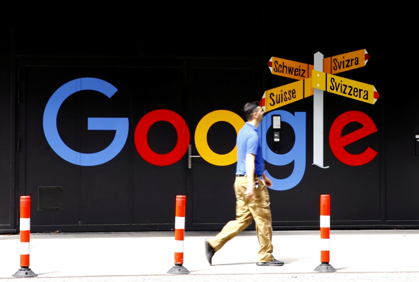 A man walks past Google's logo in front of at an office building in Zurich, Switzerland on July 1, 2020. (Reuters/Arnd Wiegmann)