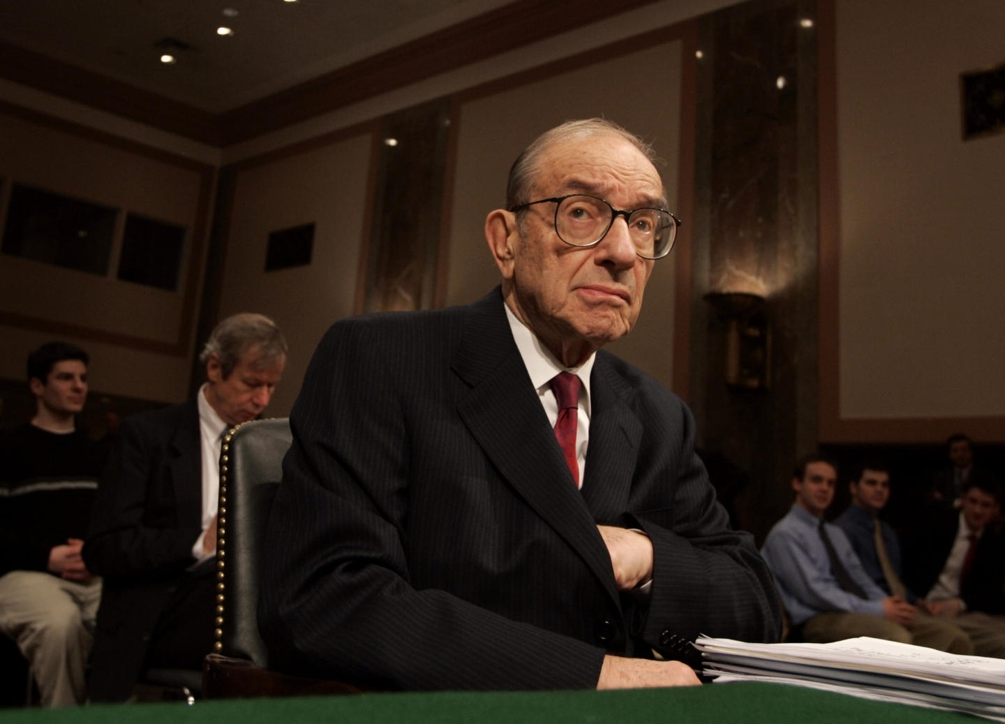 Federal Reserve Chariman Alan Greenspan pauses before the start of a Senate Banking Committee hearing on February 16, 2005 in Washington. (AP Photo/Evan Vucci)