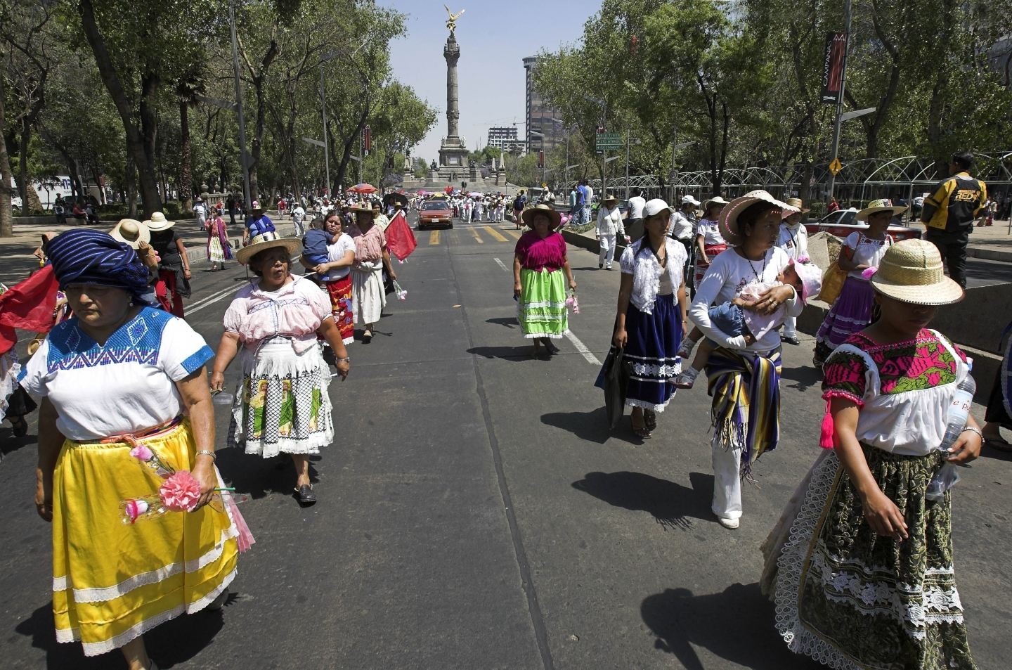 Women march through Mexico City on International Women's Day. (AP Photo/Gregory Bull)