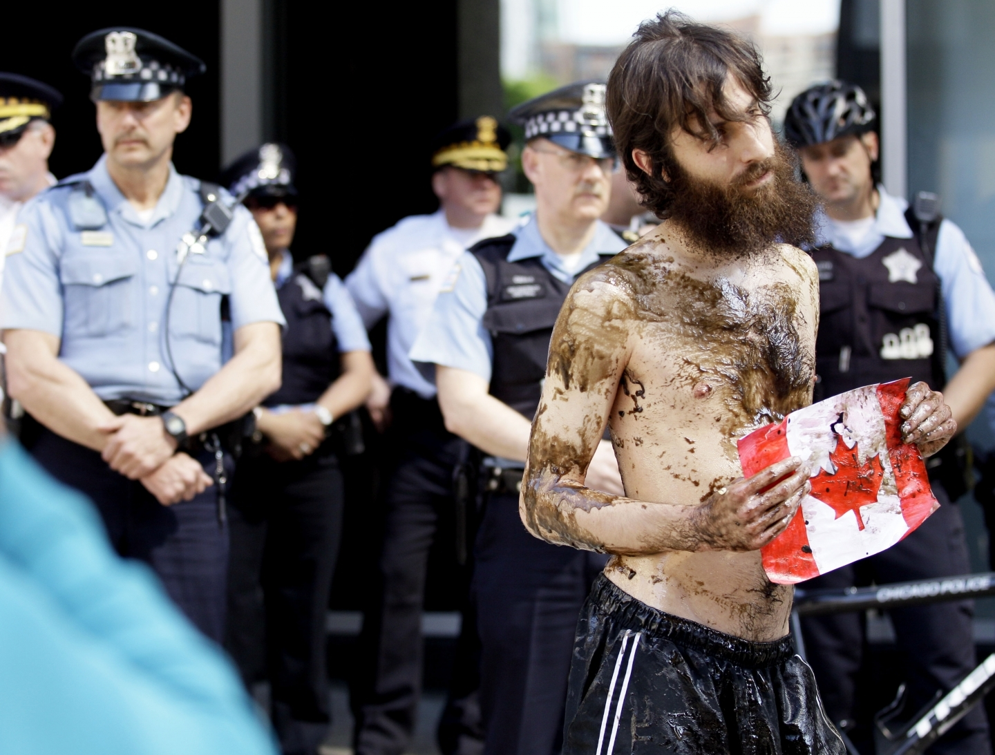 A demonstrator against pipelines at the Canadian Consulate in Chicago (AP Photo/ Nam Y. Huh)