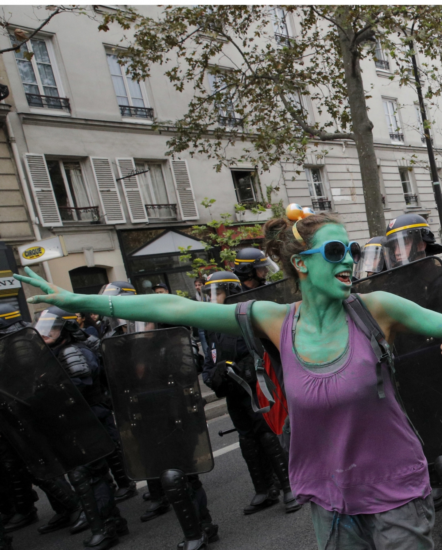 Demonstrators dance next to riot policemen during clashes in Paris over labor reforms (AP Photo/Christophe Ena)