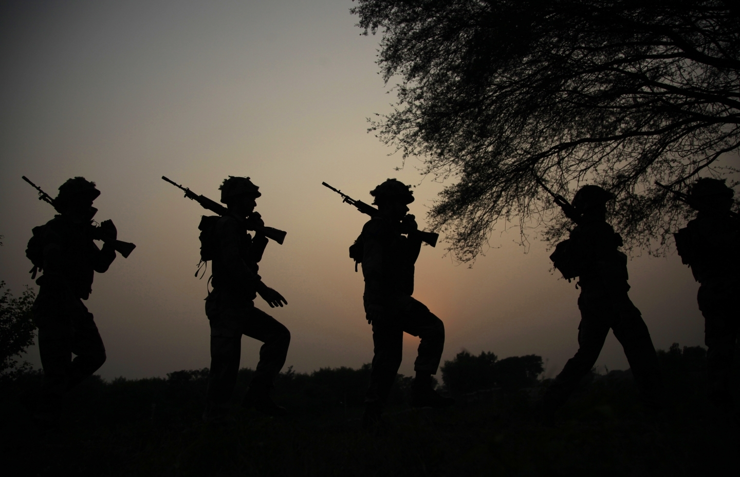 Soldiers patrol the India-Pakistan border (AP Photo/Channi Anand)