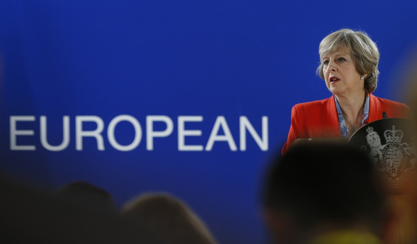 British Prime Minister Theresa May fields questions at an EU Summit in Brussels (AP Photo/Alastair Grant)