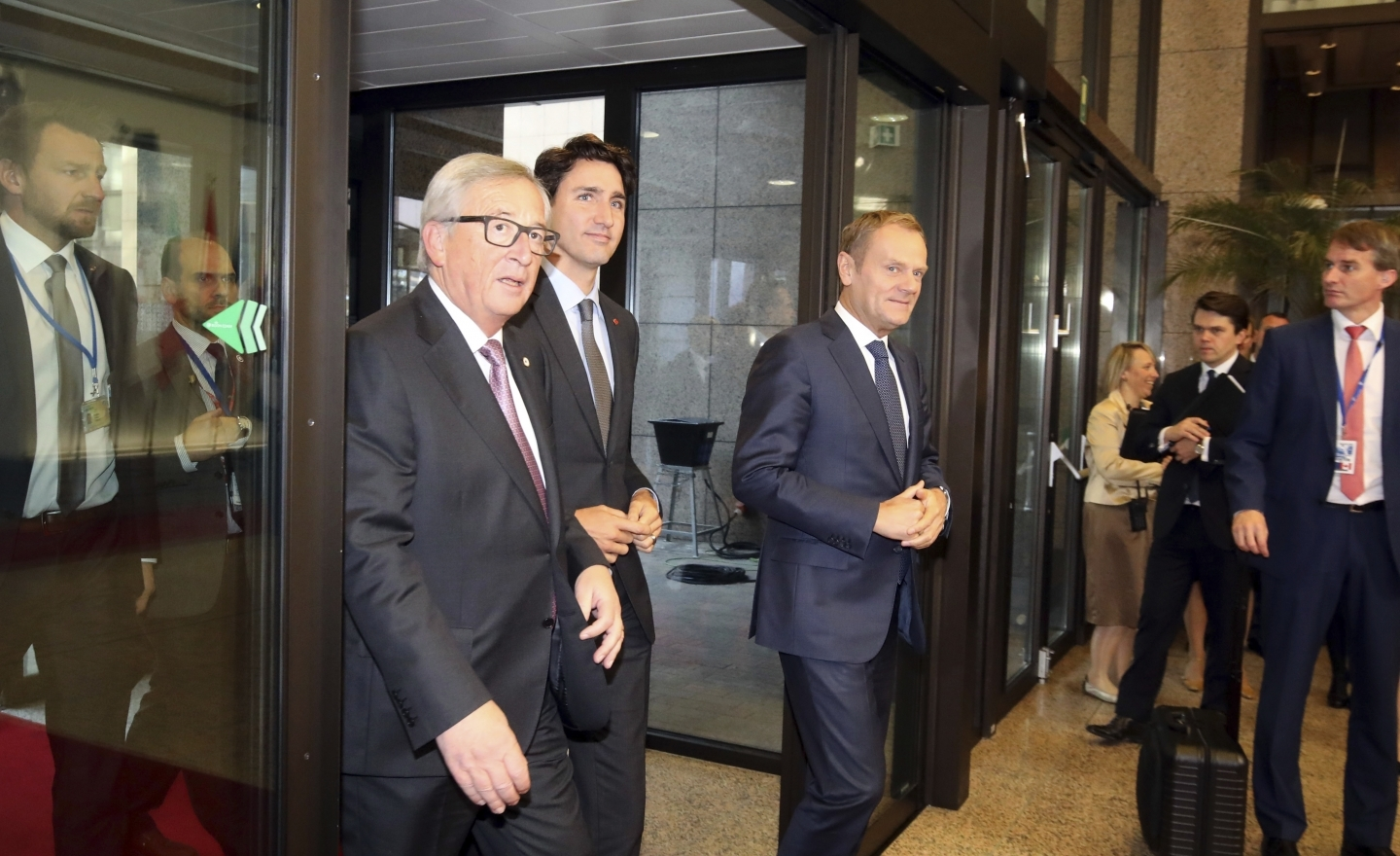Canadian Prime Minister Justin Trudeau, left, European Commission President Jean-Claude Juncker, center, and European Council President Donald Tusk, right (AP Photo/Olivier Matthys)
