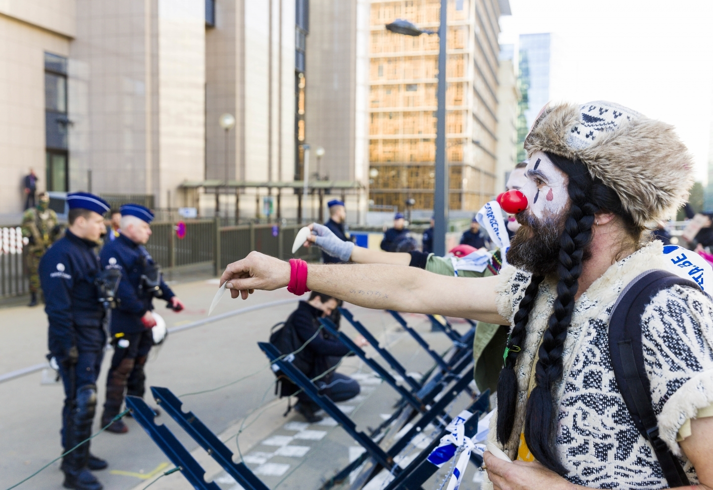 A demonstrator dressed as a clown outside of an EU-Canada summit in Brussels (AP Photo/Geert Vanden Wijngaert)