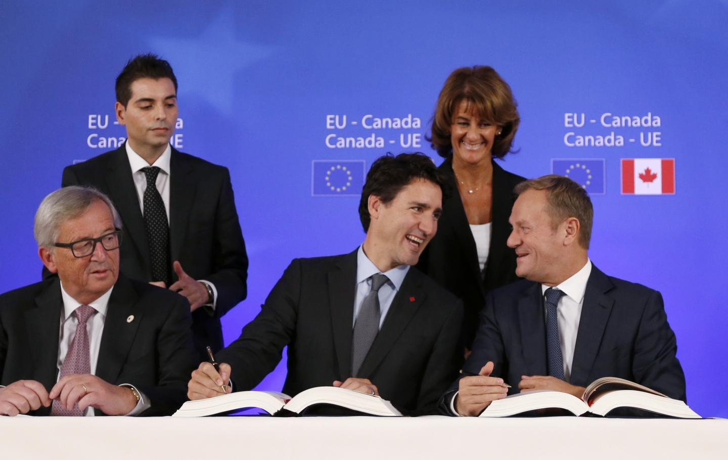 Prime Minister Justin Trudeau sits with European Council President Donald Tusk as they sign the Comprehensive Economic and Trade Agreement (CETA). (Francois Lenoir/AP Photo)