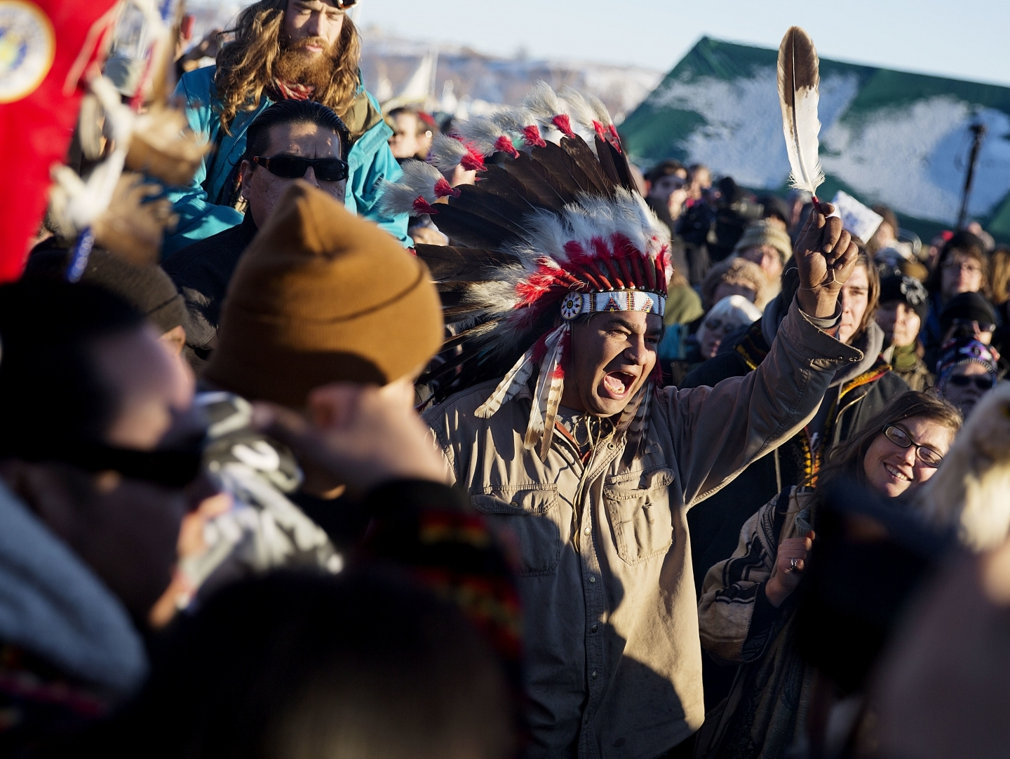 A crowd gathers in celebration at the Oceti Sakowin camp (AP Photo/David Goldman)