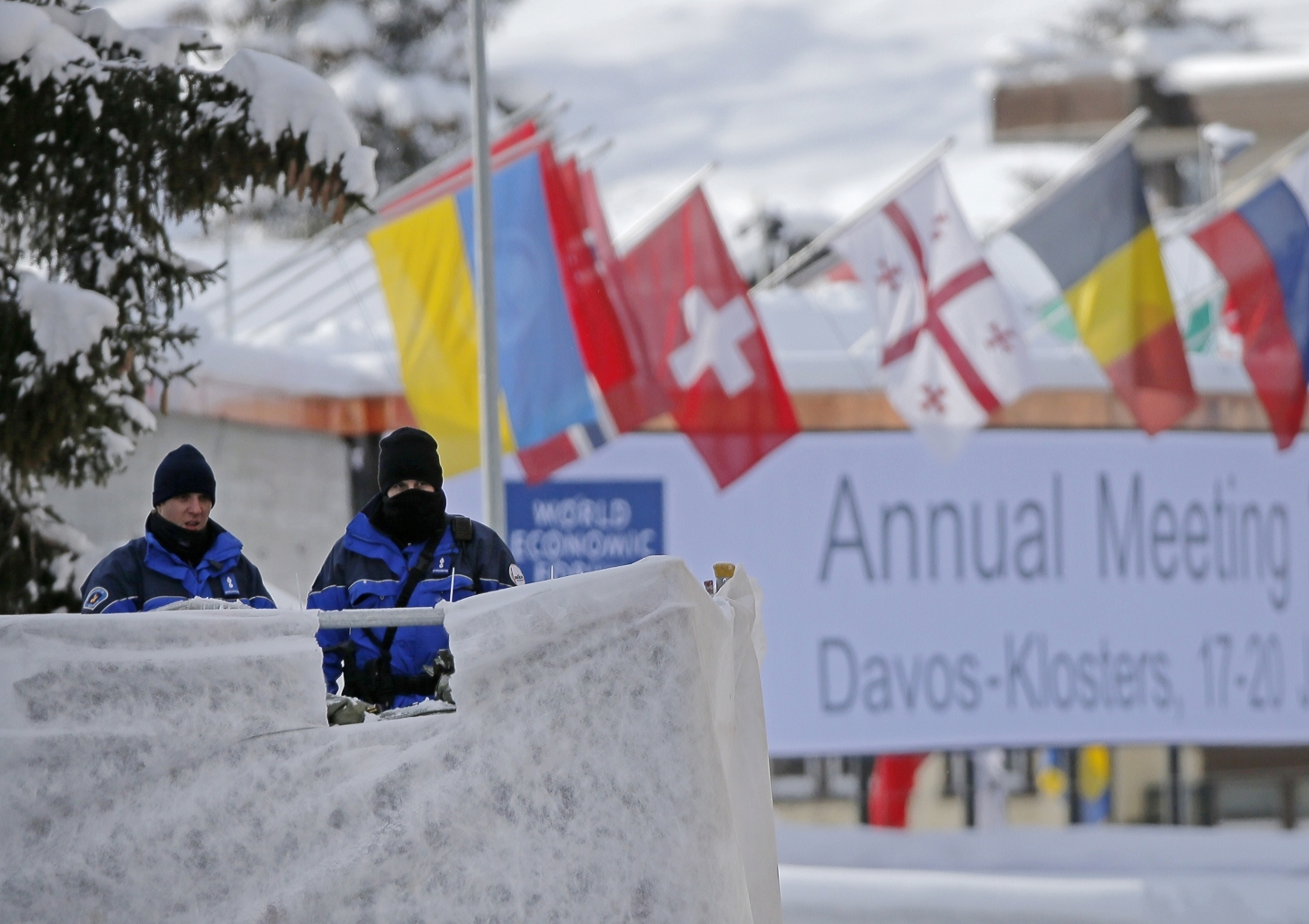 Swiss police officers guard the entrance to the World Economic Forum in Davos, Switzerland (AP Photo/Michel Euler)