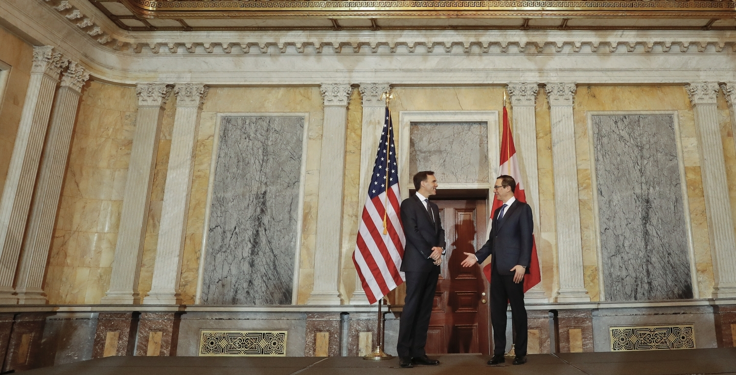 US Treasury Secretary Steven Mnuchin talks with Canadian Finance Minister William Morneau on March 1, 2017. (AP Photo/Pablo Martinez Monsivais)