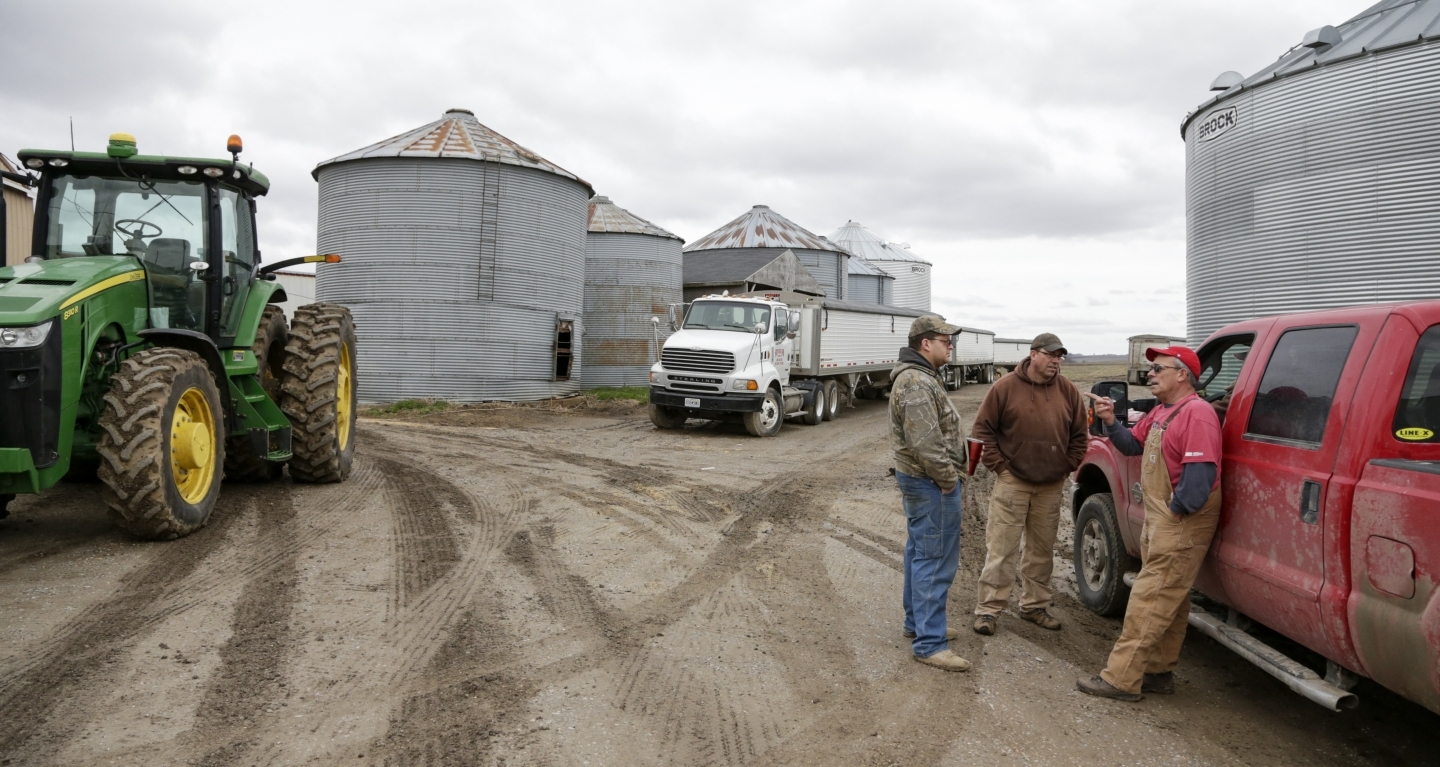 Blake Hurst, a farmer and president of the Missouri Farm Bureau, right, talks with his son and brother. The US farm lobby has been an influential voice on NAFTA talks (AP Photo/Nati Harnik)