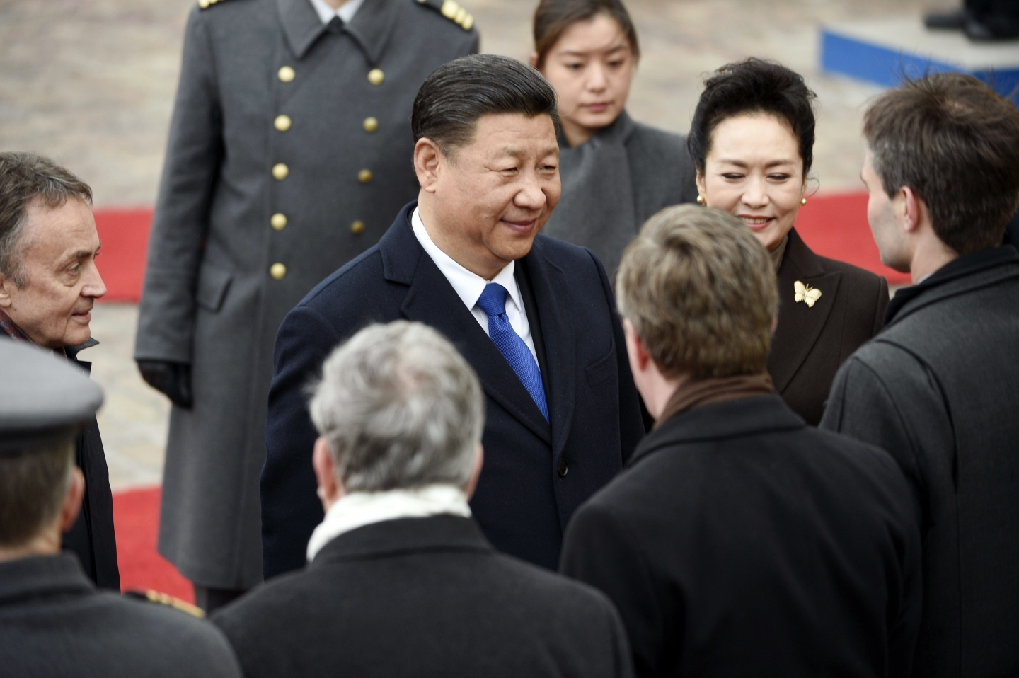 China's President Xi Jinping and his wife Peng Liyuan are greeted during the official welcoming ceremony at the Presidential Palace in Helsinki Wednesday, April 5, 2017. (Martti Kainulainen/Lehtikuva via AP)
