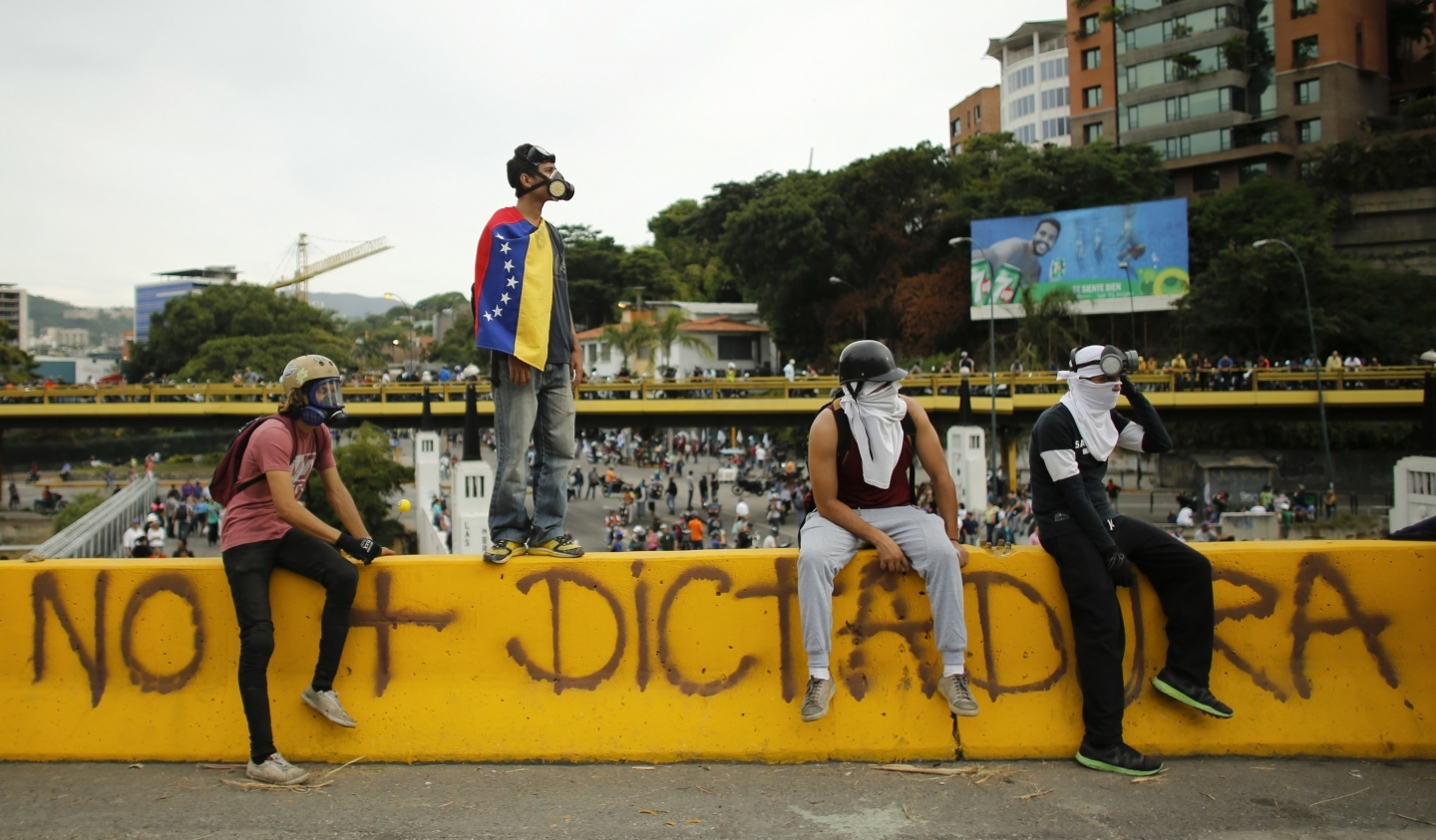 Anti-government protesters block the Francisco Fajardo highway in Caracas, Venezuela. AP Photo/Ariana Cubillos