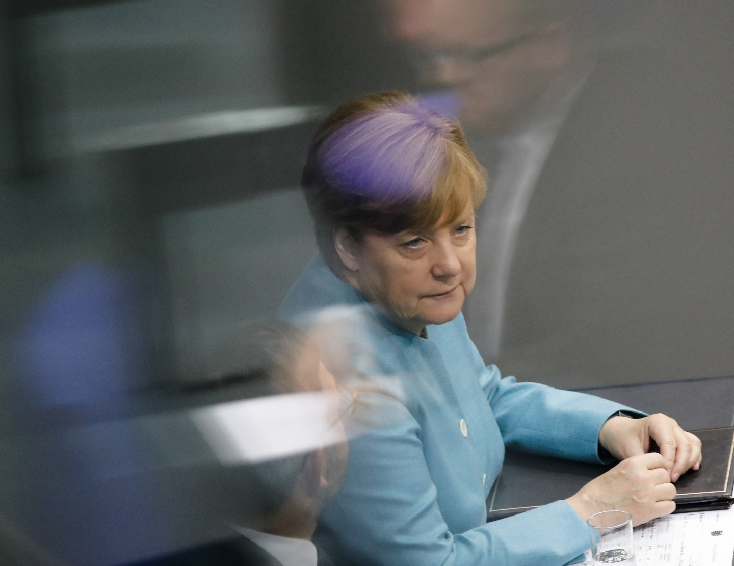 German Chancellor Angela Merkel listens during a debate in the Bundestag about the upcoming G20 Summit (AP Photo/Markus Schreiber)