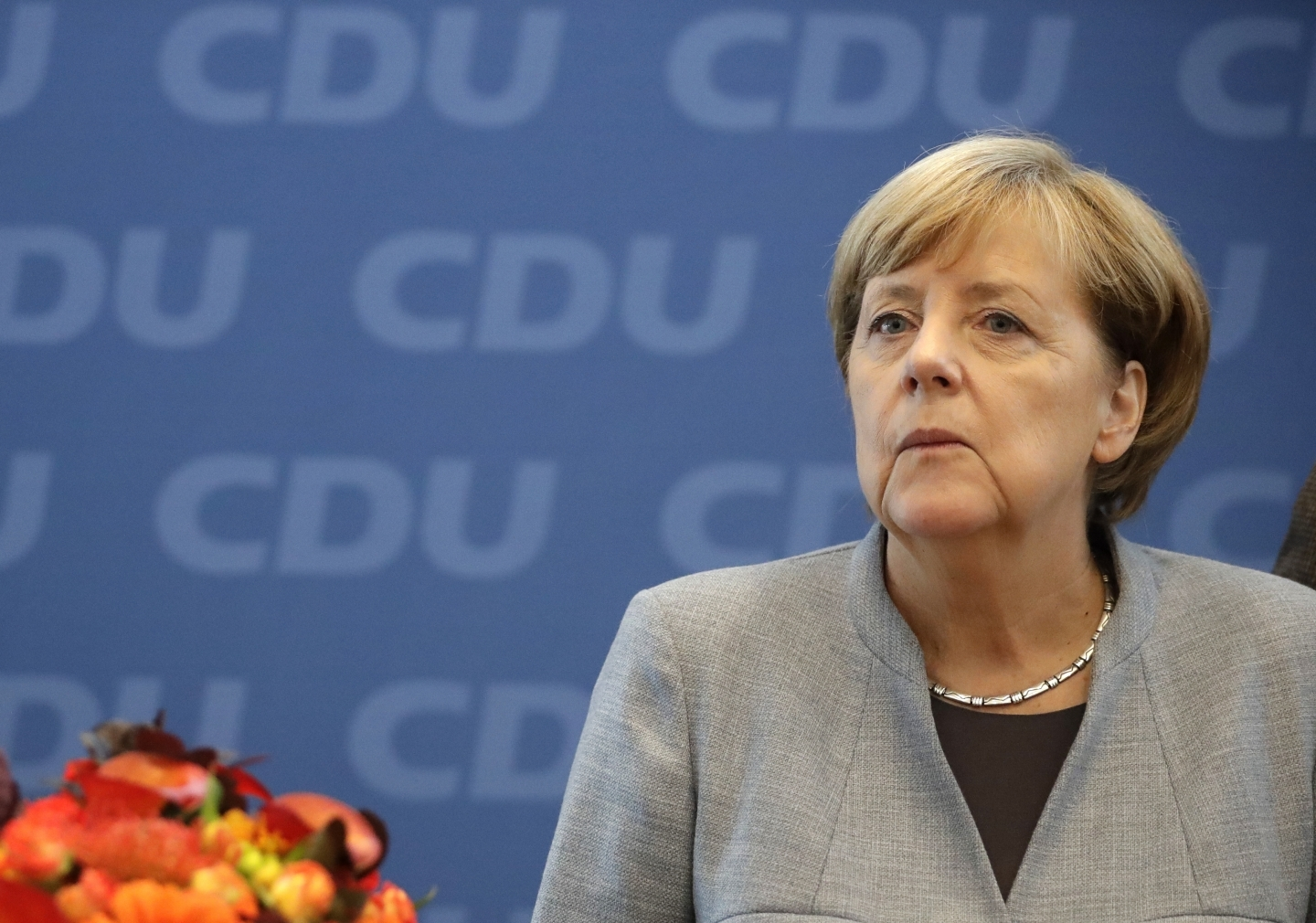 German Chancellor Angela Merkel looks on prior to a meeting of the CDU in Berlin. (AP Photo/Matthias Schrader)