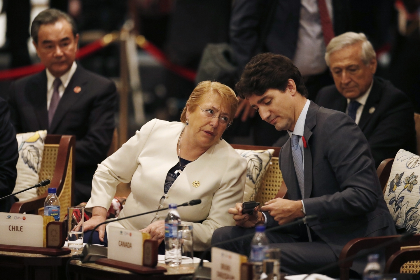 Prime Minister Justin Trudeau speaks with Chile's former president, Michelle Bachelet; both leaders have championed gender-considerate trade pacts. (Jorge Silva/AP Photo)